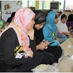 On July 23, 2010, students from the Islamic Studies, Call and Guidance Center in Manila enjoy meeting their new Christian and Muslim friends from Camp Crame Elementary School at the AAI Peace Caravan in Quezon City.