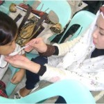 AAI Philippine Country Director Bai Rohaniza Sumndad helped feed malnourished students at Camp Crame Elementary.